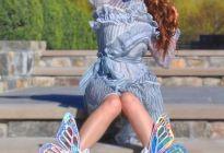 Thalia empoderada y avasallante con zapatos alados